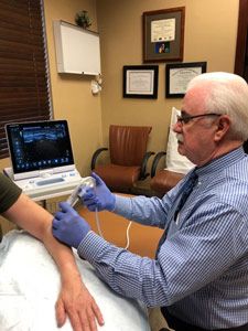 Dr. Fred performing Ultrasound on Patient